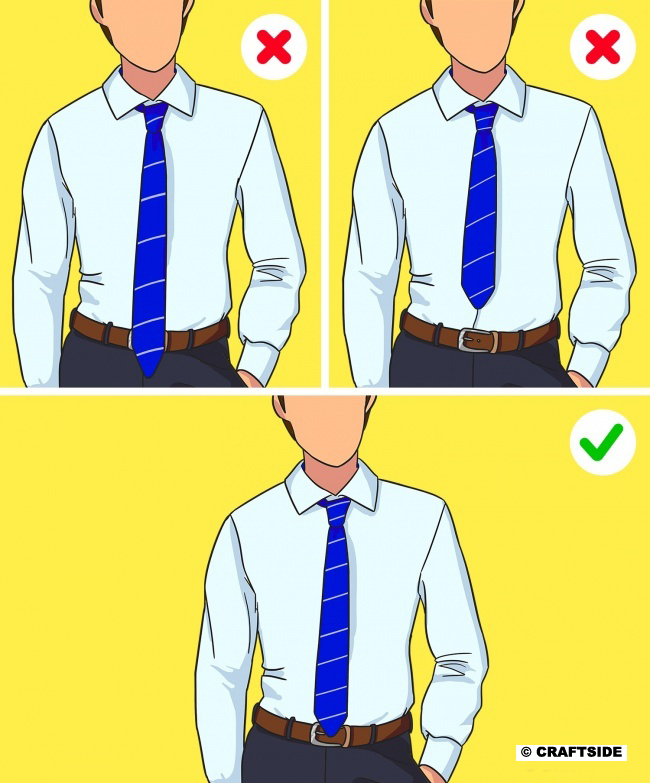 The tip of your tie should reach your waist and cross it just a little.