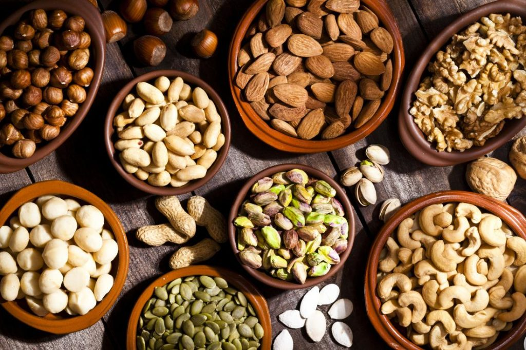 Potassium-high foods, such as almonds and pistachio nuts, can help varicose veins by reducing water retention in the body.